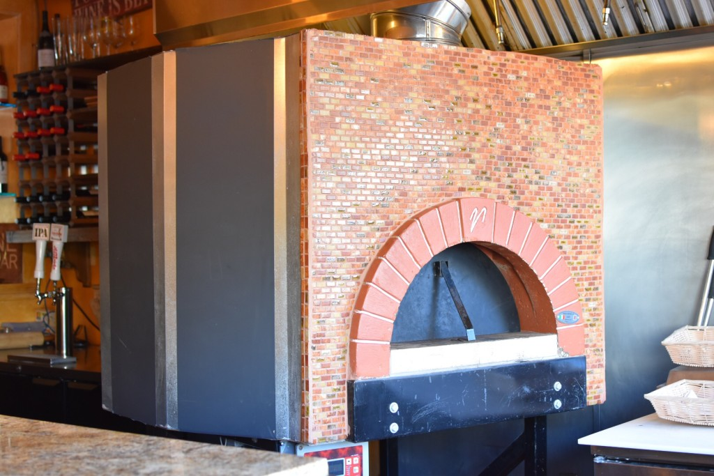 Brick oven for house-made bread; beer and wine on side | BeatsEats.com